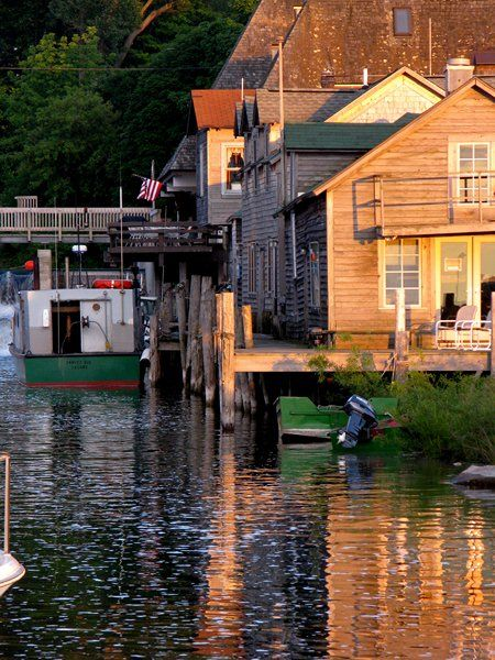 Fishtown, Leland, MI, USA is a collection of weathered fishing shanties, smokehouses, overhanging docks, fish tugs & charter boats along the Leland River. Once the heart of a commercial fishing village, the structures and docks are real places where people can walk, see and feel a connection to Lake Michigan's fishing heritage.