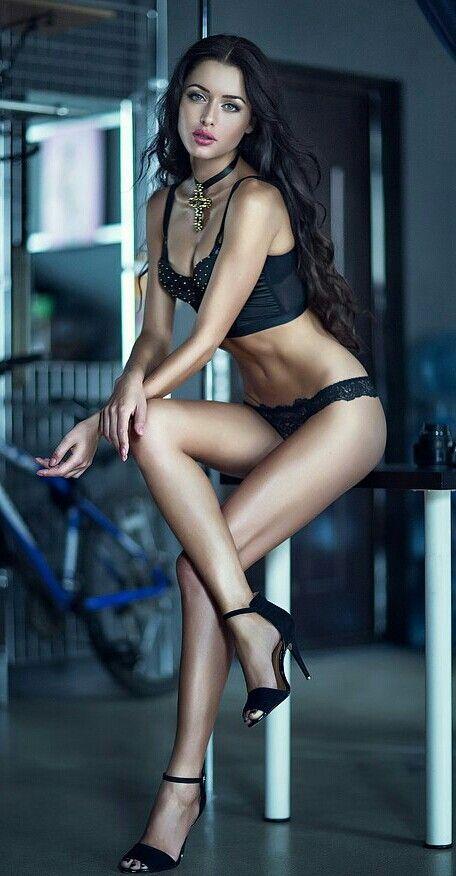 Black bra and heels long legs, simply stunning.