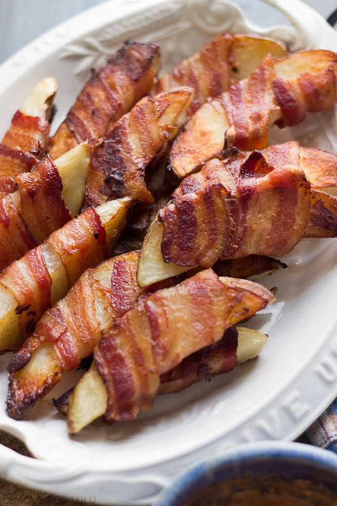 ~ Bacon wrapped roasted potatoes...These roasted potatoes are baked to perfection!  They are crispy on the outside and tender on the inside.