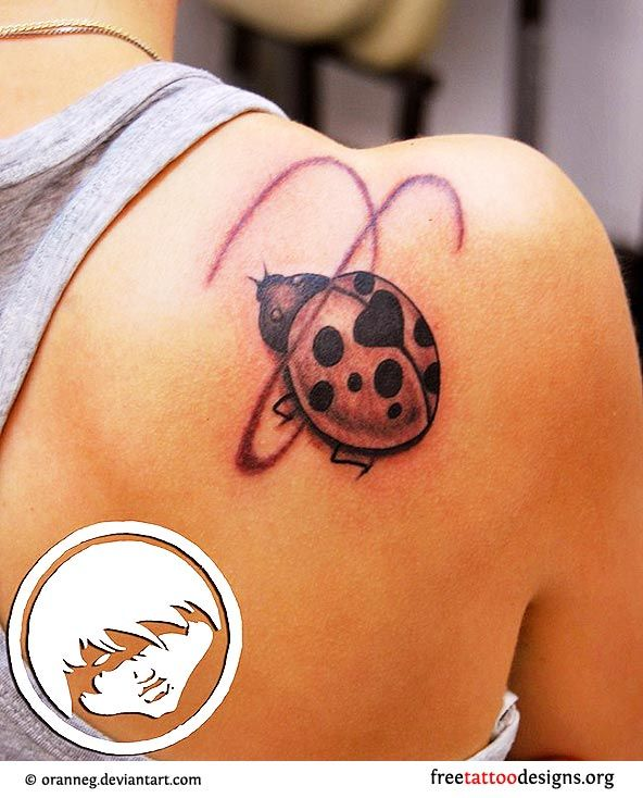 Ladybug tattoo on a woman's shoulder