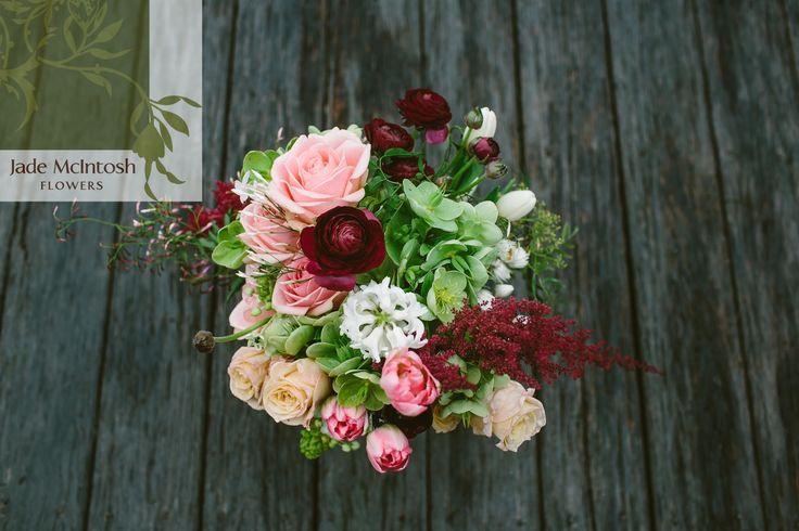 Sarah's bouquet is a delicious feast of bright greens, perfect pastel pinks and pops of burgundy. Green hellebores, maroon amaranthus, burgundy ranunculus and pink parrot tulips are some of our favourites. www.jademcintoshflowers.com.au www.cavanaghphotography.com.au