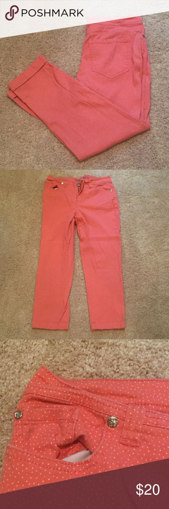 Coral Capri Pants with White Polka Dots Feminine and flattering coral capri pants with white Polka Dots. Front zipper and button, front and back pockets. Cuffed ankle. Gently worn with no blemishes or damages! I'm happy to consider offers. Code Bleu Pants Capris