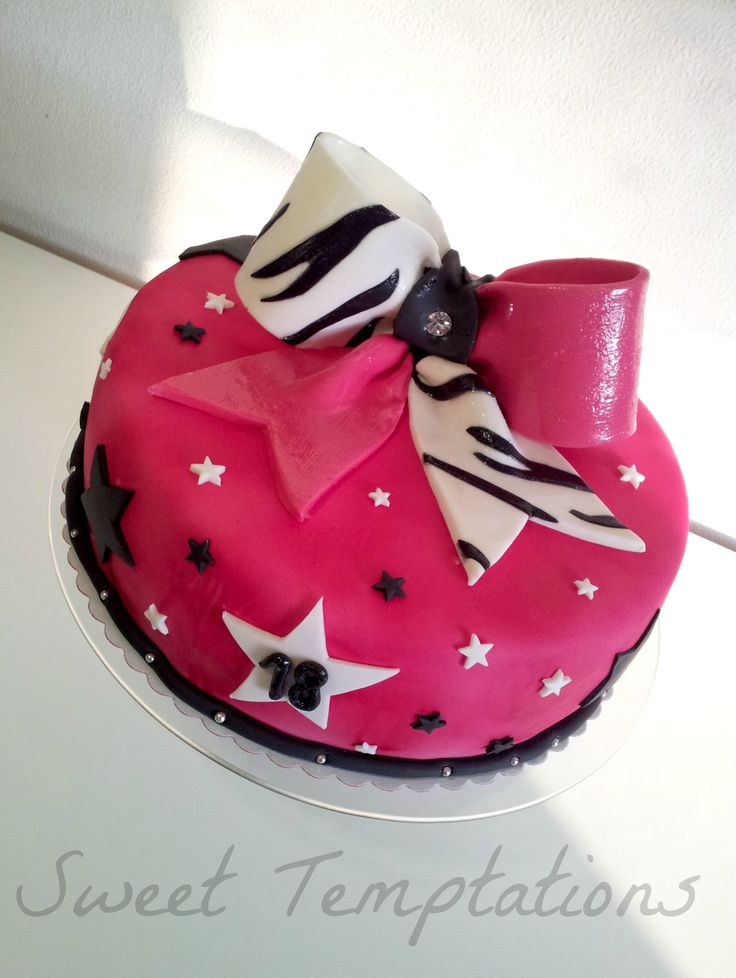 Cheerleader Bow Cake - Pink cheerbow cake filled with raspberry cream!