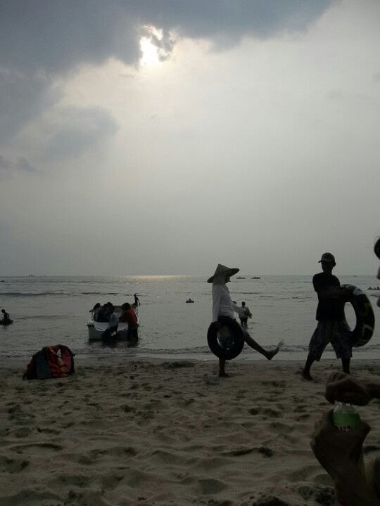 Locals and tourist. (Carita Beach, West Java.)