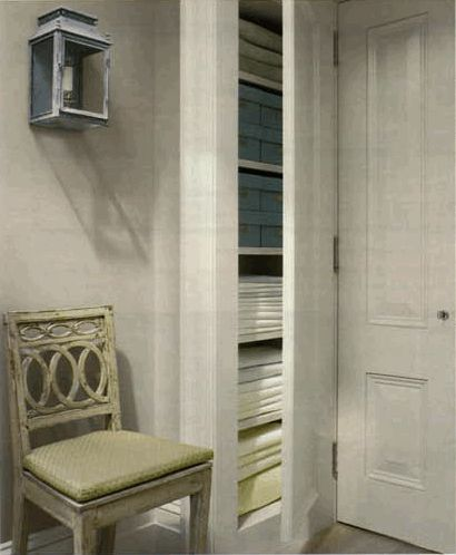 Charles Edwards Ledbury Wall Lantern lights a linen closet inconspicuous behind double doors leading into the bedroom is just deep enough to hold sheets ... & 88 best Blind Doors images on Pinterest | Hidden doors Blinds and ...