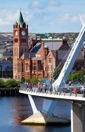 'Peace Bridge' & Guild Hall, Derry, Ireland (© scenicireland.com/Christopher Hill Photographic/Alamy)