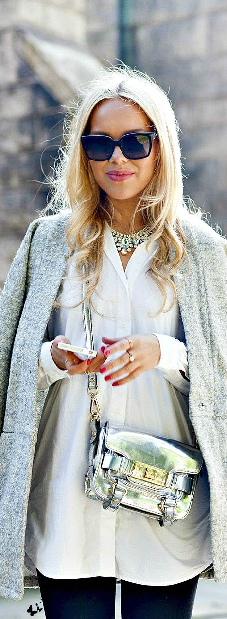 Classic coat, white shirt, statement necklace and jeans with a metallic bag is perfection!