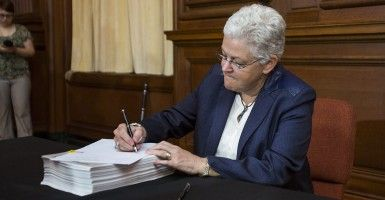 Environmental Protection Agency (EPA) administrator Gina McCarthy signs US President Barack Obama's new carbon pollution emission guideline ...