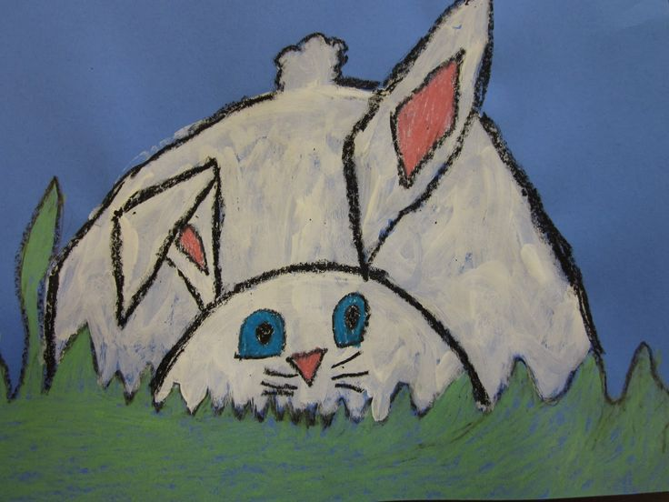 These bunnies hiding in the grass by the first graders are adorable!  We painted the bunnies and colored the details with construction paper crayons. The kids loved making that one floppy ear!  Great geometric and organic shape lesson!