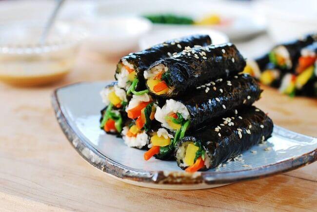 This mini gimbap or kimbap (Korean sushi rolls) is so addictive that it's called mayak gimbap, meaning drug gimbap. It's the sauce that makes this minimalist gimbap so addictive.