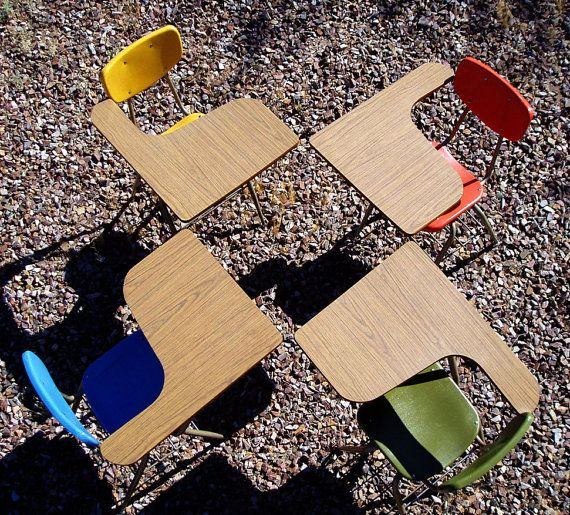 Vintage school desks. School may be a bit more fun if they all had these.