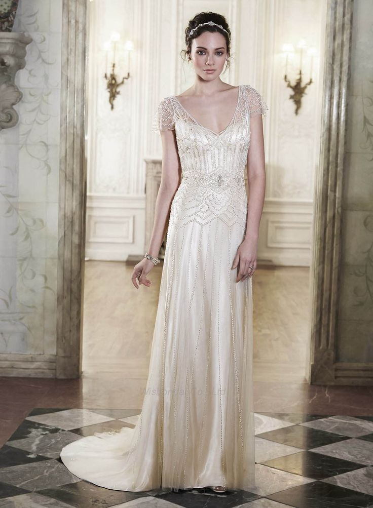 Flowy full crystal and tulle wedding dress backless low v