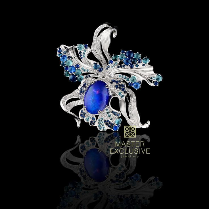 Brooch/pendant of 18K white gold, opal 5,21 ct, brillinaty, blue diamonds, blue sapphires, blue tourmalines.