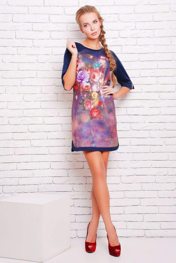 Платье-туника с цветочным рисунком цвет сиреневый  ДОЛЬЧЕ - короткое платье с рукавом 3/4 реглан. Рукава и окантовка платья выполнены из однотонного материала. Изюминкой платья является очень красивый набивной цветочный винтажный рисунокв стиле прованс в ярких тонах. Платье можно носить и как тунику под леггинсы.