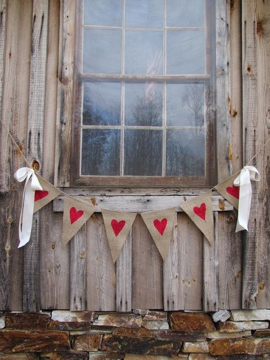 Heart Burlap Pennant Banner sewn to a continuous piece of jute twine with Big Floppy Cream Satin Bows.  Links to Etsy shop to