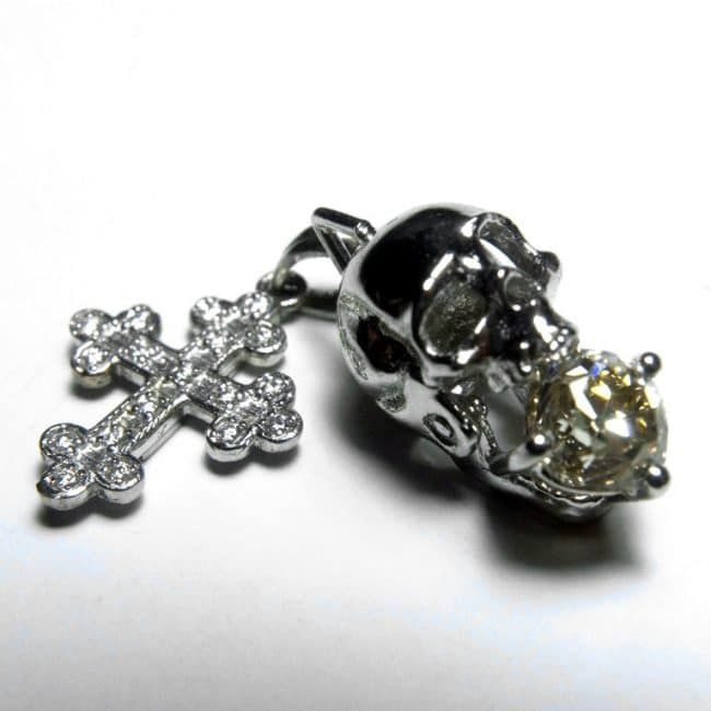 When we started our own line of jewellery, we made two things before we made anything. The first was a cross; the second was a skull. Both are symbols that are worked quite literally to death, so we knew it wasn't going to be easy!  Here they are in platinum.  #platinum #skull #cross #finejewelry #diamonds