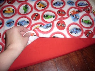 "Nap Mat Pattern -- Kindermat Cover Pattern: unclear instructions. used 21"" x 44"" of patterned fabric for top, then longer for bottom, to make envelope pocket for mat?"