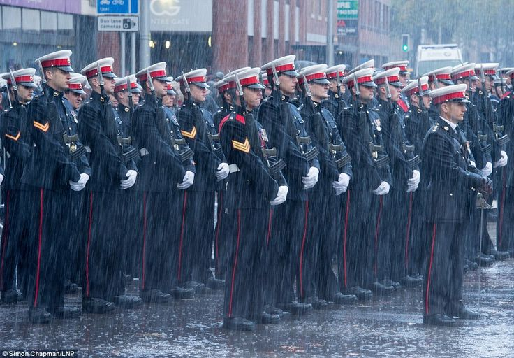 Soldiers in Bristol stood stoic in the rain in Bristol as they honoured those killed durin...