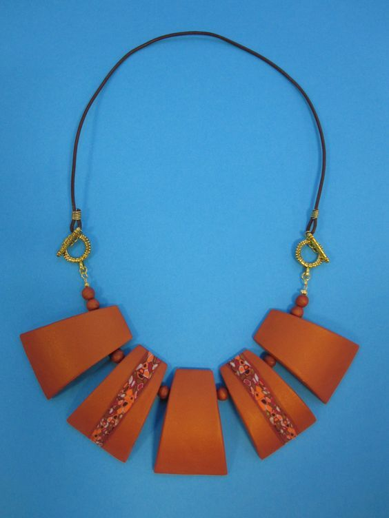 Heather's feat of polymer engineering - this stylish sectioned collar necklace with Mica clay and Klimt Cane, offset with gold findings and leather thong. Beautiful execution - very well done!: