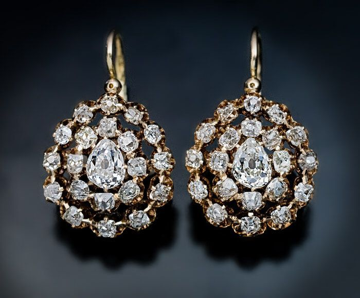 Antique Russian Late 1800s Diamond Gold Drop Earrings. 14K gold drop earrings are set with ~3 carats of sparkling bright white old cut diamonds. Each earring is centered with an old pear cut diamond surrounded by two rows of graduating old mine cut diamonds. The pear cut diamonds are 0.41 ct and 0.43 ct.