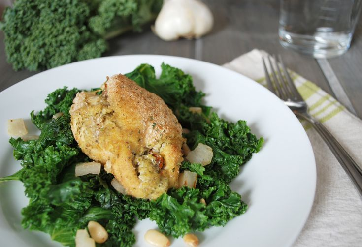 stuffed chicken and sautéed kale with toasted pine nuts