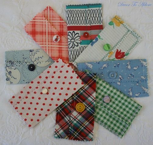 Fabric Envelopes. This lady has some great ideas.  These would make nice money folders, coupon holders, travel organizers...hm.