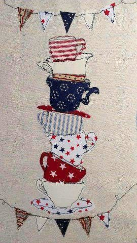 Teacups Applique- I like this because it resembles Alice in Wonderland and it has made a photo out fabrics.