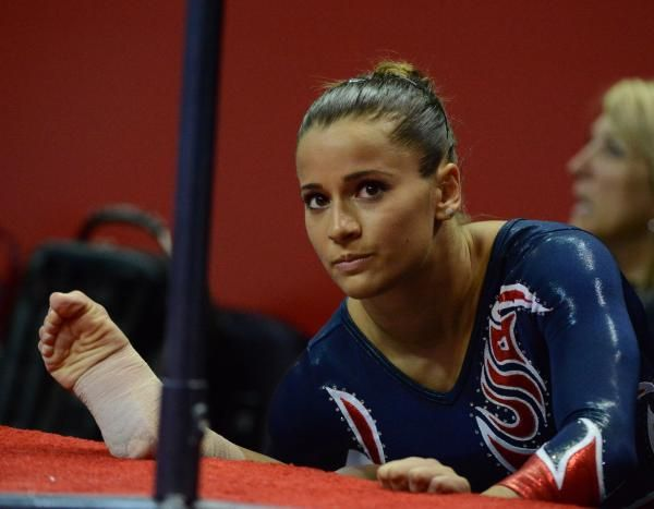 Alicia Sacramone stretches before performing on the beam at the US Olympic trials