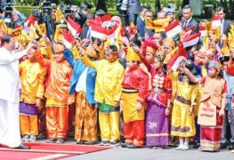 Indonesian President Joko Widodo warmly welcomed  President Maithripala Sirisena when he arrived at the Merdeka Palace, the official residence of the President of Indonesia, marking the first state visit to Indonesia by a Sri Lankan Head of State in 40 years.President Maithripala Sirisena is seen greeting  Indonesians who arrived at Merdeka Palace to welcome him. Picture by Sudath Silva