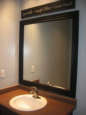 Add a frame to your plain mirror. TIP: if you have those big clips holding your mirror in place replace them with a washer so that it is flat & then add the molding.