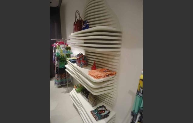 Nice store outfit. Love the layered shelving - Custo Barcelona, Westfield, Stratford