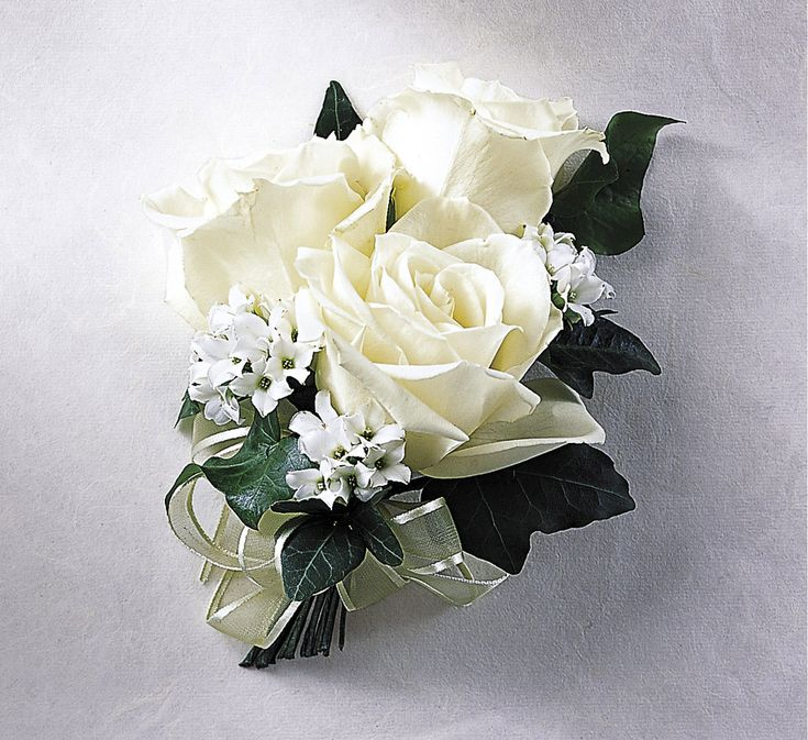 CORSAGE TUTORIALS  http://www.wedding-flowers-and-reception-ideas.com/how-to-make-a-corsage.html    White roses, bouvardia and ivy leaves with sheer ribbon accent.
