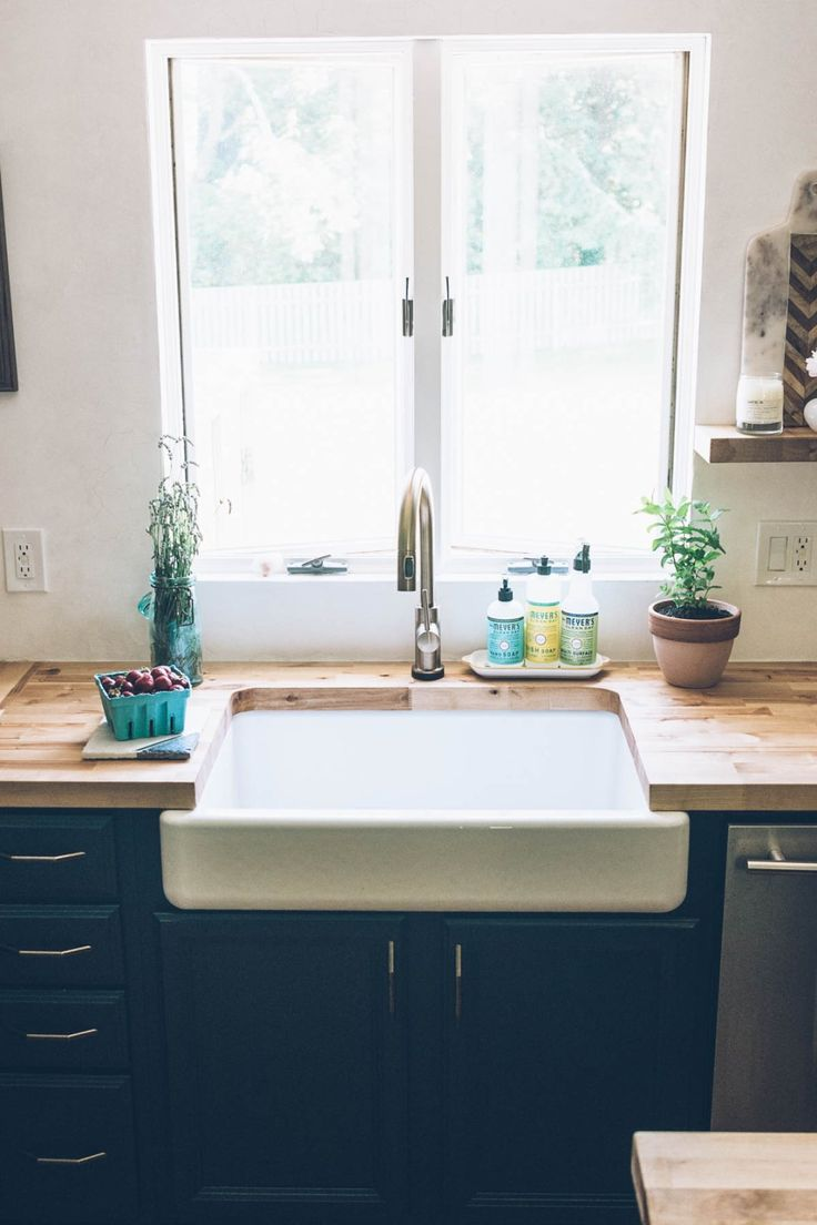 Jess Kirby kitchen renovation farmhouse sink and brass faucet