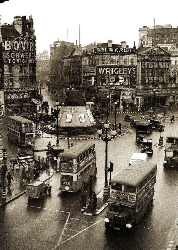 London England in the early 1900s... Piccadilly Circus and double decker buses