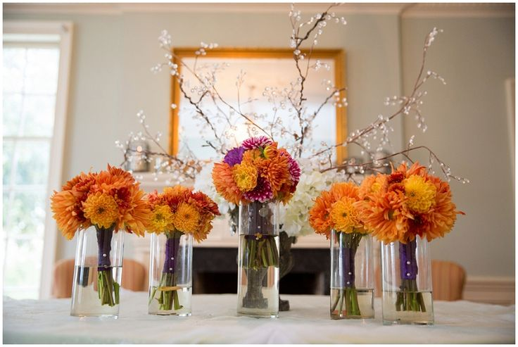 orange and purple wedding flowers // Photo by Ellen Leroy