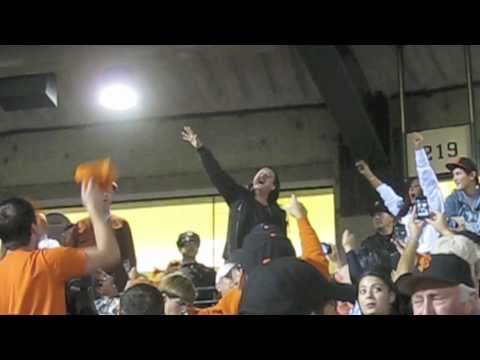 Steve Perry of Journey sings along to 'Lights' during Game 2 of the 2010 World Series