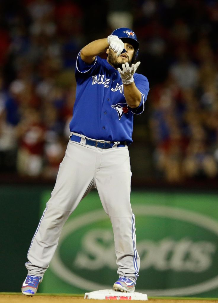 Toronto Blue Jays catcher Dioner Navarro (30) gestures from second base after hitting a double against the Texas Rangers during the third inning in Game 3 of baseball's American League Division Series in Arlington, Texas on Sunday, Oct. 11, 2015. (AP / LM Otero)