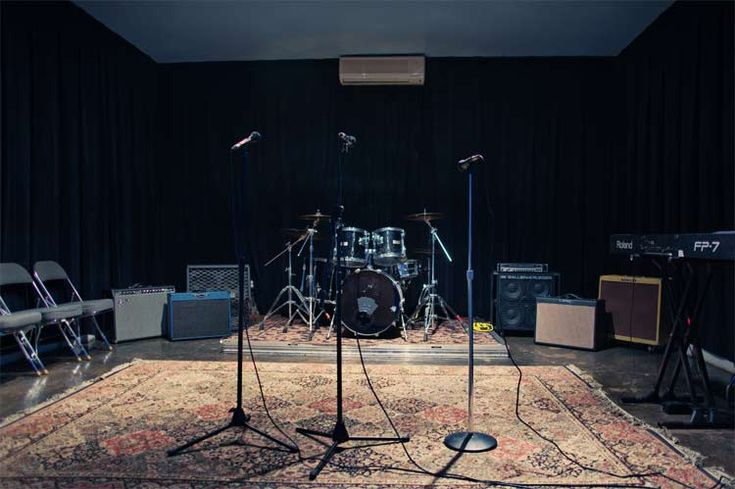 The Arts-Angels rock band rehearsal space might look something like this--complete with the oriental rug.