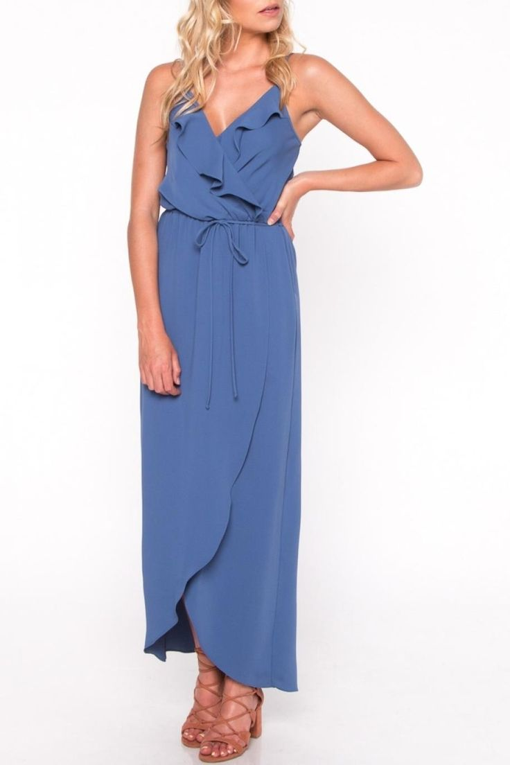 A blue maxi dress featuring a flowy silhouette and ruffled wrap detail with waist tie and subtle front slit.   Blue Ruffle Maxi Dress by Everly. Clothing - Dresses - Maxi Clothing - Dresses - Shift Virginia