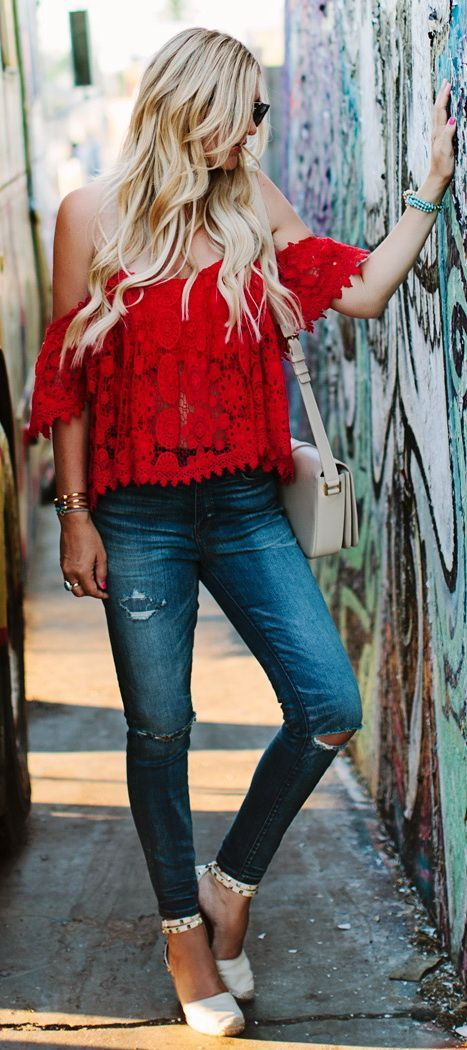 Red off-shoulder top and high rise ripped denim.