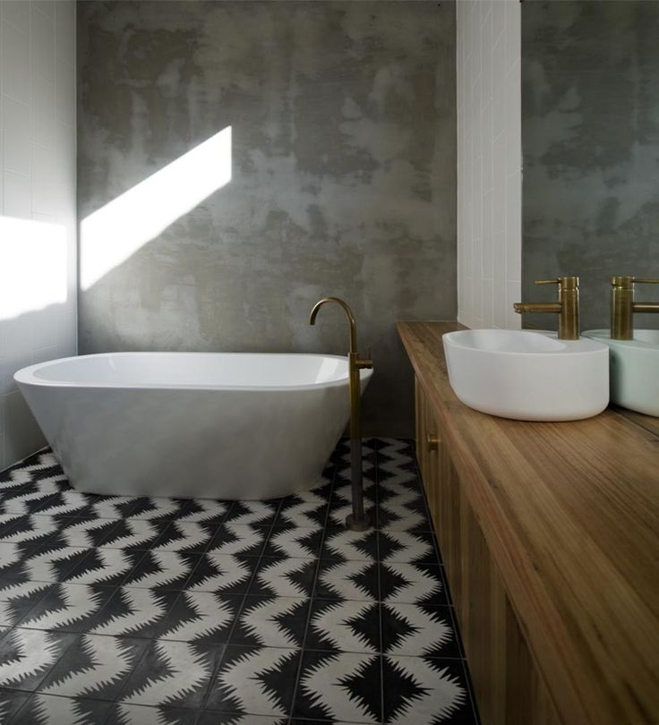 Attrayant Contemporary Bath With Concrete Walls, Wood Vanity, White Fixtures With  Brass Faucets, U0026 Graphic Black U0026 White Tile That Is Used Throughout The  Home ,by ...