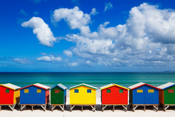 Landscape photo of multicolour beach huts on Muizenberg beach.   www.hougaardmalan.com