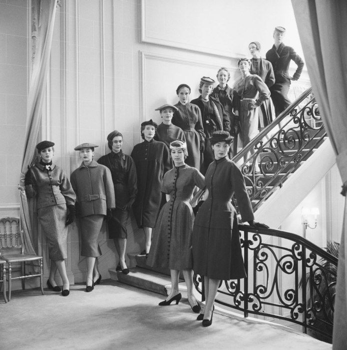 Thirteen was Christian Dior's favorite number and he was highly superstitious, which explains why there were 13 models in his cabine. Here is one group, lined up on the staircase outside the Grand Salon before a highly anticipated trip to Japan. (Autumn-Winter 1953 haute-couture collection.) Photo:  Mark Shaw