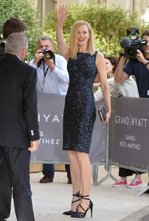 Getting the party started: Nicole Kidman shows off her perfect figure as she attends a photocall in her role as a juror at the Cannes Film Festival in Italy on Tuesday