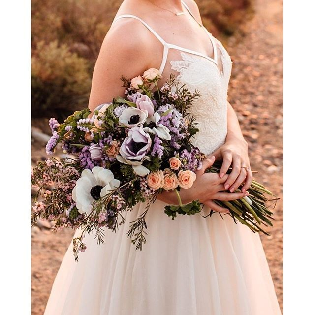 The bouquet and boutonniere were created by The Flower Story Co. with the easy feel of an elopement in mind. The bouquet was designed as if the bride had gone out to the fields to pick the flowers herself. Photo by @tminspired /Bridal Attire: @nicanddaybridal /C