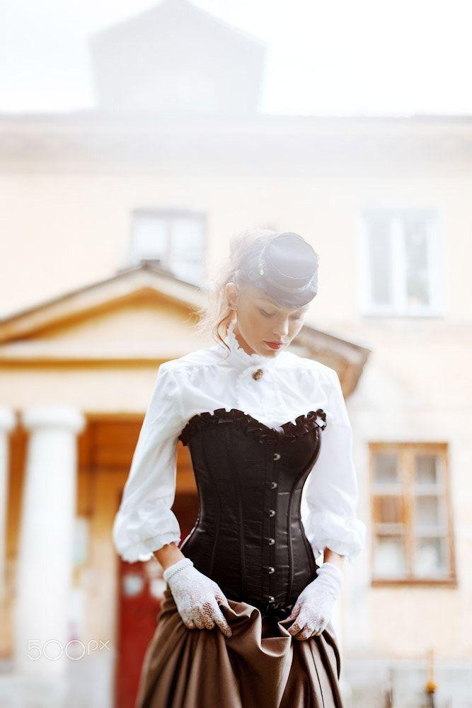 Beautiful woman in vintage dress - Beautiful woman in vintage dress. Selective focus. Retro style.