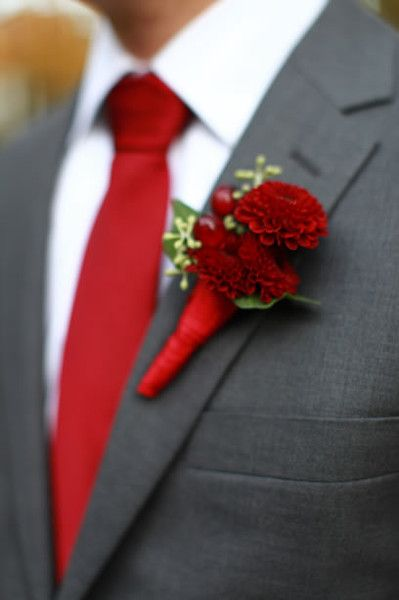 A crimson red tie and dahlia boutonniere is both dapper and bold for a fall wedding! {Samantha Robshaw Photography}