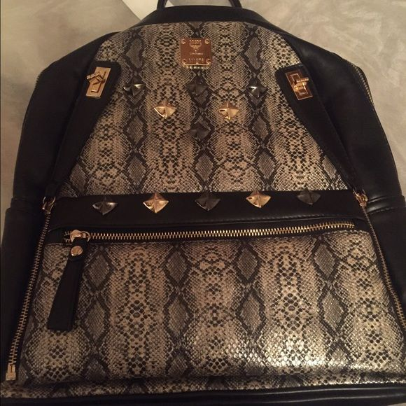 MCM Snakeskin Backpack Authentic MCM backpack, Tags & All , WILLING TO NEGOTIATE THE PRICE... MCM Bags Backpacks