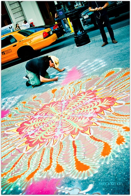 Union Sq, NYC. He makes his art with colored sand that he sifts through his hand. Isn't that unbelievable?