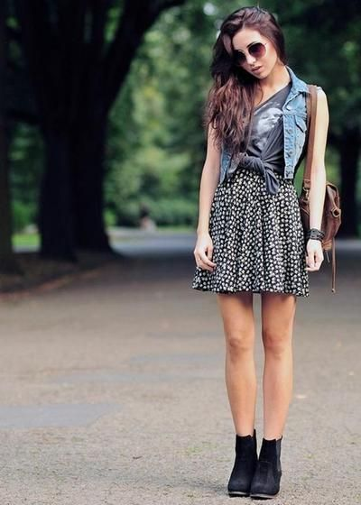 This look is awesome. Layer your vest over a graphic tee and printed skirt. Add booties instead of sandals for a more chic look.